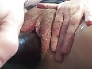 Slut stretches hairy cunt